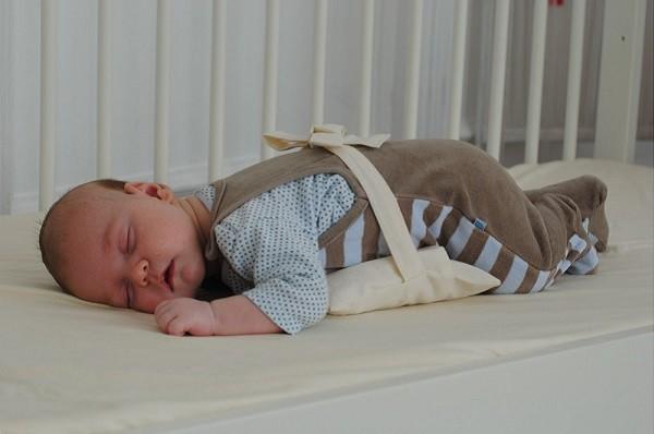 грелка на живот новорожденному